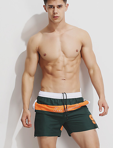 homme sportif bleu vert cale on de bain bas maillots de. Black Bedroom Furniture Sets. Home Design Ideas